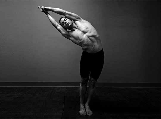 guy with pectus excavatum doing yoga